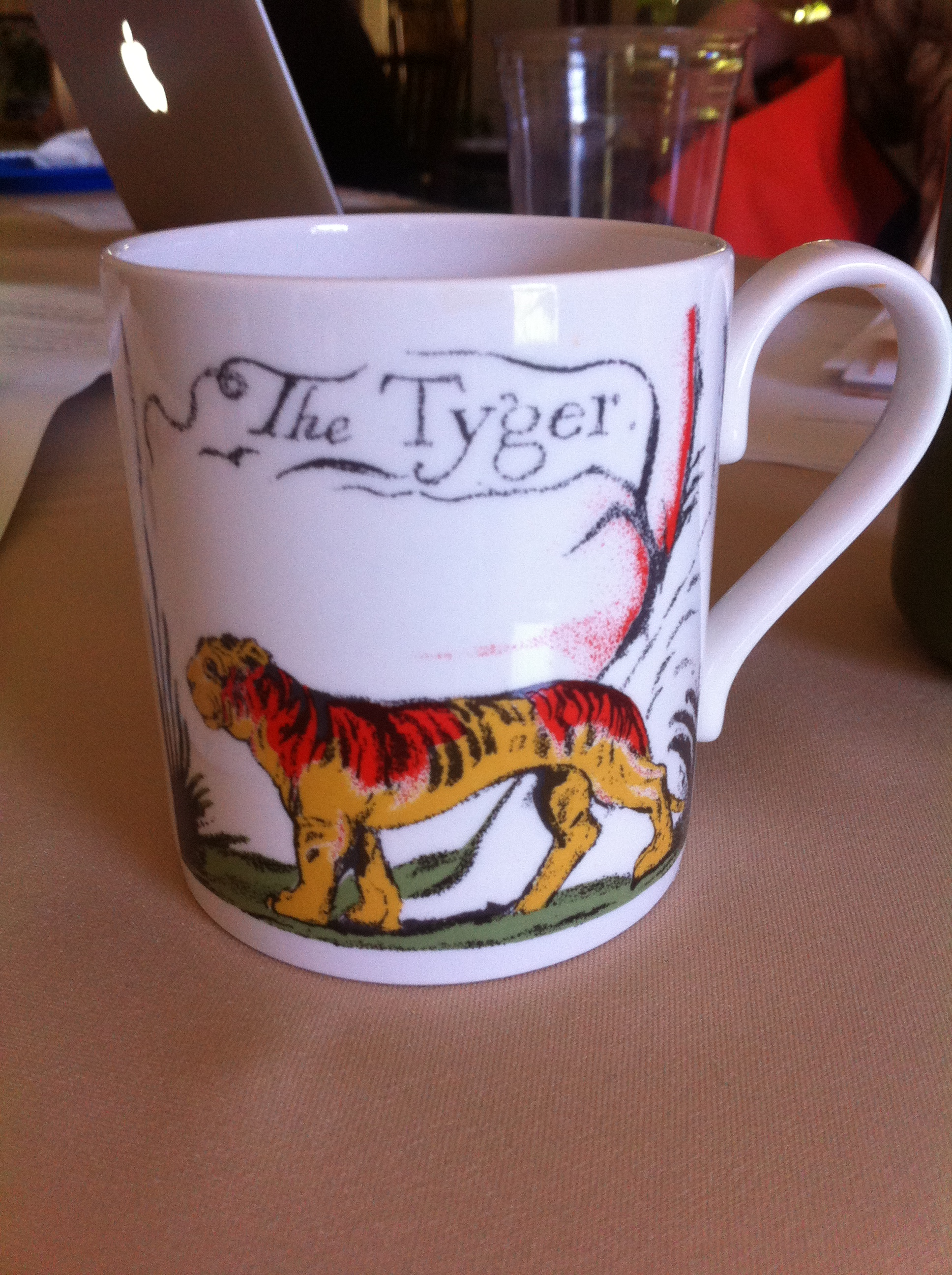 "Coffee mug featuring William Blake's poem ""The Tyger."""