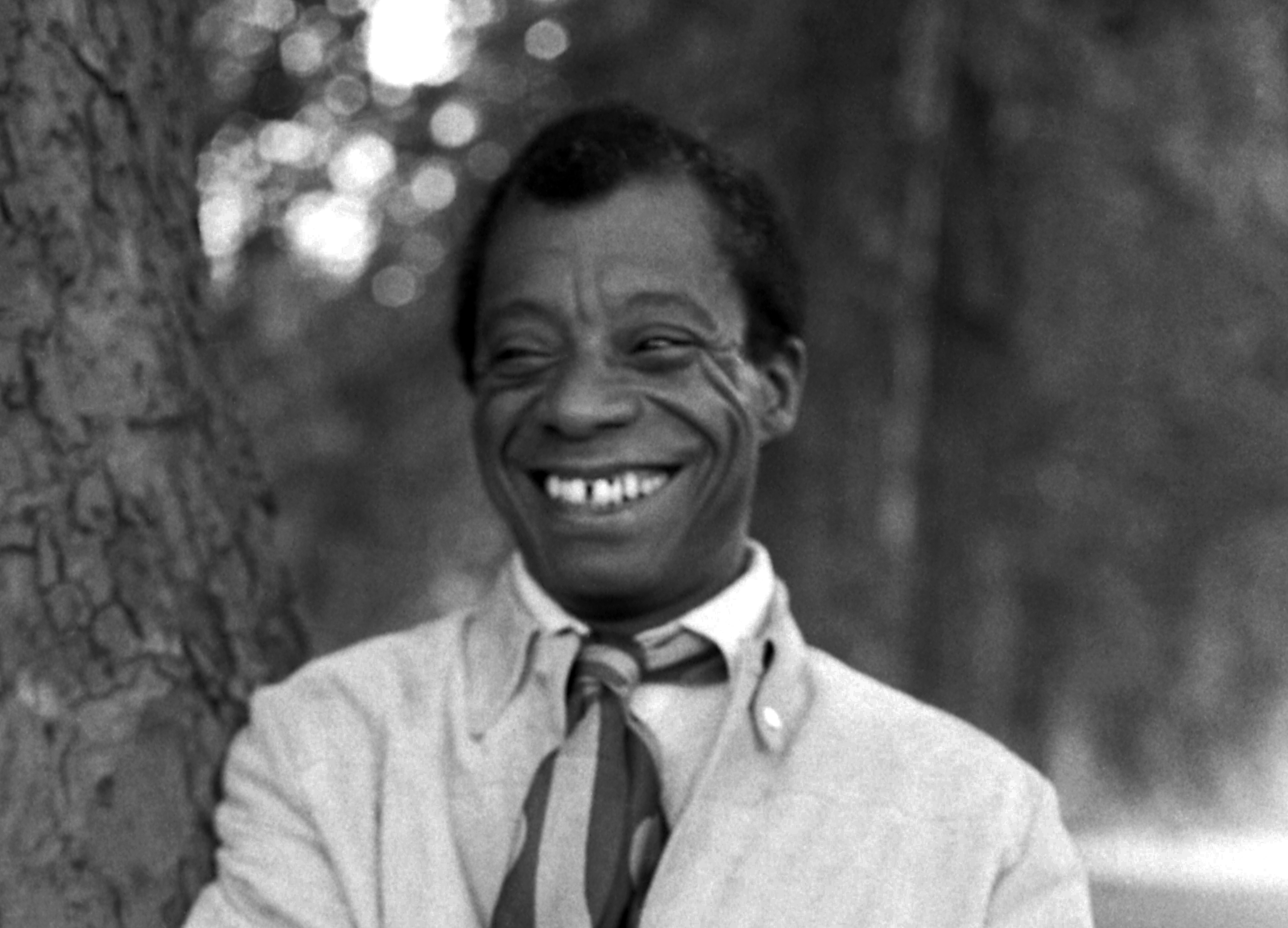 James Baldwin in Hyde Park, 1969. Original image cropped. Attribution: Allan Warren [CC BY-SA 4.0 (https://creativecommons.org/licenses/by-sa/4.0)]. Source: https://commons.wikimedia.org/wiki/File:James_Baldwin_08_Allan_Warren.jpg.